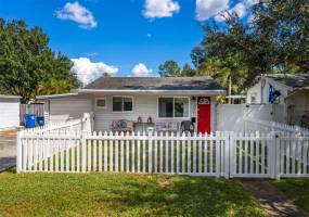 An inviting fenced front yard, front porch and front door!!